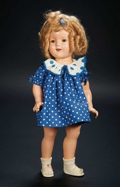 "Shirley Temple owned Composition Doll by Ideal in Rare Publicity Costume 18""s,   marked Shirley Temple, Ideal N&T Co. The doll is wearing a blue cotton dress with white polka dots and contrasting dotted collar, inspired by publicity photos of Shirley taken at the time of release of ""Baby Take a Bow"" film of 1934. Z"