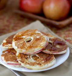 Thin slices of apples dipped in pancake batter and then cooked in a skillet.