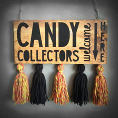 Let trick–or–treaters know if you have treats...  Reversible Halloween sign: Side 1 - Candy Collectors Welcome Here Side 2 - Sorry, No More Candy