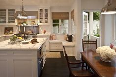 Love, love, love this kitchen!  Love the little seating area in addition to the table/chairs.  Great for entertaining!