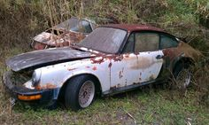Double Tragedy... Two rusting Porsche 911s.