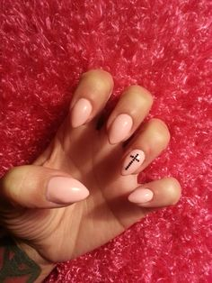 Pretty in pink almond / pointed nails gel polish over acrylic cross / crucifix black glitter nail art