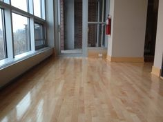 We refinished these maple hardwood floors in downtown Minneapolis