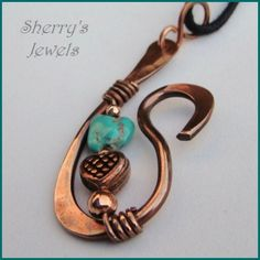 A real turquoise nugget (clear stabilized) and a copper heart, on pure copper, carefully shaped and hammered.The pendant measures a smidge under 2 1/2 inches tall and 1 inches wide, hanging on a cotton cord 19 inches long, with handmade clasp.