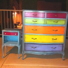 Just finished this rainbow dresser and night stand. It was such a fun project!