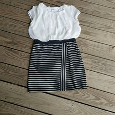   dress   Black stripe bottom, white flowy top.  Dress size xl juniors.  Bust 20 length 33.  Poly spandex blend.  All measurements are approximate Dresses