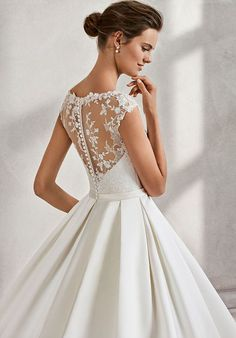 Classic-style beaded lace and duchess satin wedding dress with illusion neckline, in ivory.