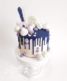 Purple, white and mint green drip cake. By Jenelle's Custom Cakes.
