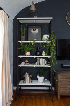 Floor to ceiling bookshelves house lots of plants and unique decorative details!