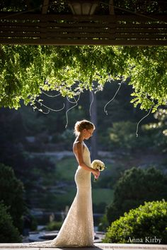 beautiful... garden background with vines over arch with bride in foreground