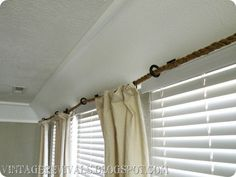 "This is it! Love the rope ""curtain rod"" and the boat cleat to anchor it on one end. She used drop clothes for curtains. We have a winner! Perfect for my sunroom. Cute, easy and cheap! kh"