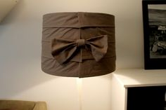 Shabby chic lamp shade, diy. Made of a piece of dark beige sheet and masking tape (yes.)