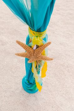 Yellow and Turquoise Beach Wedding Ceremony Decor with Starfish