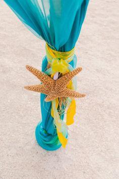 Yellow and Turquoise Beach Wedding Ceremony Decor with Starfish