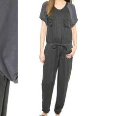 NWOT Free People utility jumpsuit Super soft dark gray relaxed fit utility jumpsuit with chest and hip pockets. Rolled ankle cuffs. Snaps down the front and drawstring waist. It's a very relaxed fit so I think it can also fit size sm-med. Purchased on freepeople.com. Photos from freepeople.com. Free People Pants Jumpsuits & Rompers