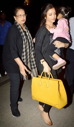 Mother Brindya Rai lends daughter Aishwarya Rai Bachchan a helping hand at the Mumbai airport. #Style #Bollywood #Fashion #Beauty