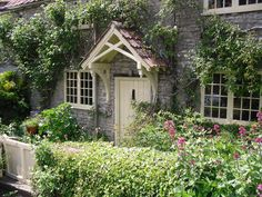Stone country cottage with detailed painted porch
