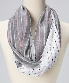Achieve that timeless look with this perfectly posh scarf. The dainty construction and contemporary color combination come together for a playfully sophisticated piece that will gracefully tie together any luxe look.