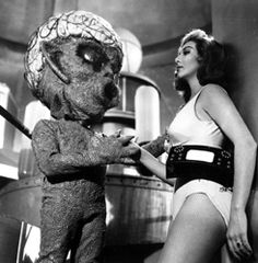 A Venusian was chosen to sing to the winner of the Miss Universe Pageant that year.  Kludoorp did a fair job.