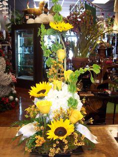 Sunflower's, Rose's, Hydrangea, Bells of Ireland and Wax flower