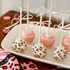 Gal pals will go wild for these pink safari baby shower cake pops with snazzy leopard spots, zebra stripes and itsy-bitsy ribbons. Oh baby!