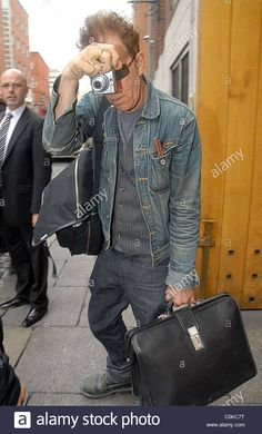 Download this stock image: Tom Waits takes photos of photographers as he leaves the Clarence hotel in Dublin Dublin, Ireland - 01.08.08 - C0KC7T from Alamy's library of millions of high resolution stock photos, illustrations and vectors.