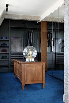 truly masculine closet with a fine wooden sideboard