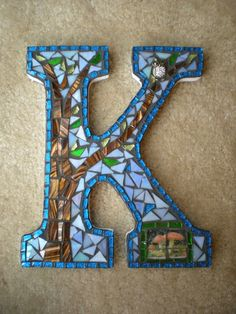I created this mosaic letter K using a variety of tiles in greens and blues. I adore owls, so I decided to create a mosaic using an owl as the Mosaic Crafts, Mosaic Projects, Mosaic Art, Mosaic Glass, Mosaic Tiles, Glass Art, Craft Projects, Owl Mosaic, Stained Glass