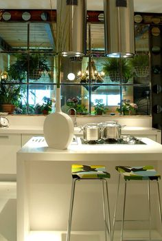 Kitchen with blocked view, opens beautifully with a windowed sunroom and greenery. Problem solved!