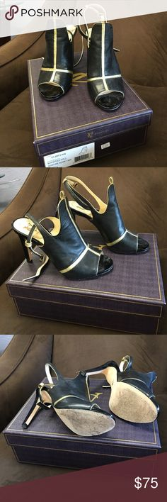 Vero Cuoio Signature VI-BRYAN size 7 heel Classy and sassy size 7 boot show in black with gold trim worn a couple of times... vero cuoio  Shoes Heels
