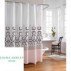 The Yardley shower curtain features a vertical running damask embroidery. While the footer of the curtain has a thin taupe panel with a larger pink panel at the bottom.