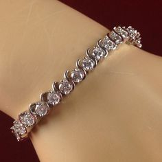 White Sapphire Rhodium Plated Swirled Tennis Bracelet JMA270/RH. Starting at $1