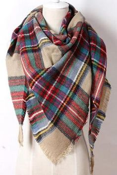 This lightweight Tan and Red Plaid Blanket Scarf is a must have this winter! Material: Modal Scarves dimensions: 75inx55inx55in (triangle) Note: dimensions of scarf may vary slightly Please allow 2-3