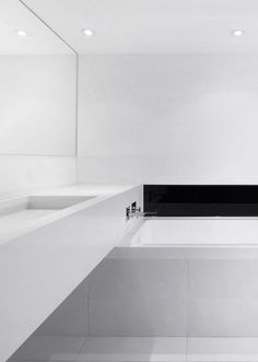 Minimalist bathroom 327285097922624129 - an ultra minimalist white bathroom with a black built in fireplace and a long vanity Source by Minimalist Bathroom Design, Minimal Bathroom, Minimalist Home Decor, Modern Bathroom Design, Minimalist Interior, Bathroom Interior, Bath Design, Small Basement Bathroom, Add A Bathroom