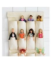 Cute Idea. Barbie storage in a over the door shoe organizer.  Needed to pin the organizer to the wall because it tips forward with the dolls in there.  But I love how organized it is and Sam loves putting the dolls in their beds :)