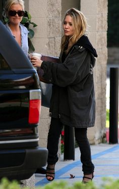 Mary-Kate in an oversized parka, black skinny jeans and Stella McCartney mesh…
