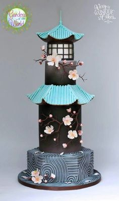Cherry blossom and pagoda Asian themed wedding cake in black and turquoise