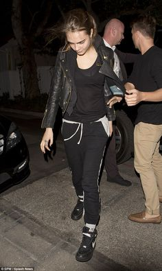 Casual: The model wore black and grey joggers with a hoodie and leather jacket...