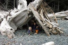 Brandon and Riley in driftwood fort