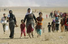 Shocking: Members of the Iraqi Yazidi sect flee to refugee camps after their town was overrun by ISIS. One Iraqi girl (not pictured) has told of horrific treatment as a sex slave after being captured by the extremist group