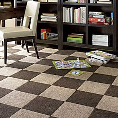 Peel and stick carpet tile. This might be the way to go in the basement?