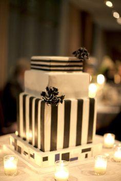We love this super chic striped cake. #weddingcakes
