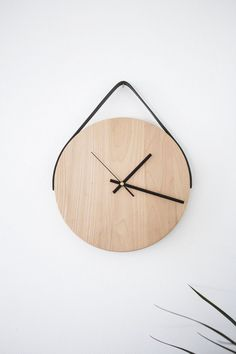 This modern + minimalist wall clock makes quite the statement.