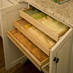 several shallow shelves instead of deep shelves to store table linens visibly