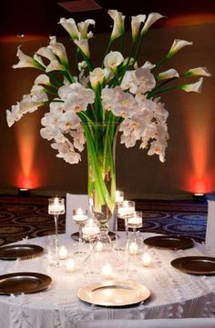 Orchid and Calla Lily centerpieces Calla Lily Centerpieces, Spring Wedding Centerpieces, White Centerpiece, Table Centerpieces, Wedding Decorations, Church Decorations, Spring Weddings, Centrepieces, Centerpiece Flowers
