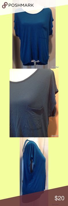Blue Top With Open Back Size: XL. 100% Rayon. Tops