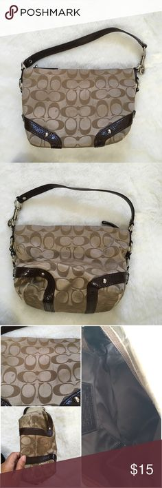 Coach F44143 brown jacquard purse Good condition. Spots on the bottom and sides. Lining is in good condition Coach Bags