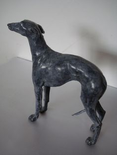 Little or Small Whippet Bronze Standing sculptures statuettes or Ornaments For Sale for Indoors Inside Interiors in House or Home by Emma Walker the Accomplished Animal sculptor. Dimension : 9 x 9 x 3.4 cm (height x width x depth)  approx: 3 1/2 in x 3 1/2 in x 1 1/3 in It is a maquette sculpture