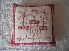 reminiscent of the old redwork  embroidery... cute and simple :)