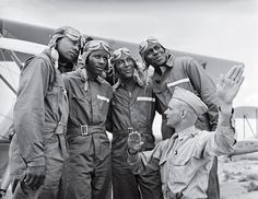 life View post → Members of the U.S. Army Air Corps' legendary 99th Pursuit Squadron, the Tuskegee Airmen, receive instruction about wind currents from a lieutenant in 1942. The Tuskegee fliers — the nation's first African American air squadron — served with distinction in the segregated American military.